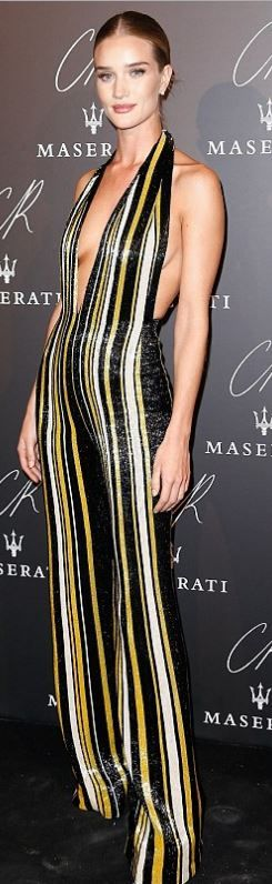 Who made  Rosie Huntington-Whiteley's black, white, and yellow stripe jumpsuit that she wore in Paris on September 30, 2014