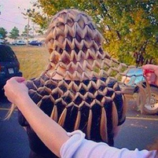How cool is this hair do! Just one thing, lots of elastics in there to take out :D if any guard had like a princess theme or a theme which involved fishnet...... This would a be atone consuming but cool thing to see.