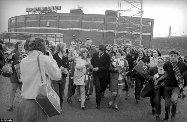 No stranger to attention Manchester United superstar George Best (centre) is seen here in April 1969 as he is mobbed by men, women and children all eager to get a picture or autograph from their hero.