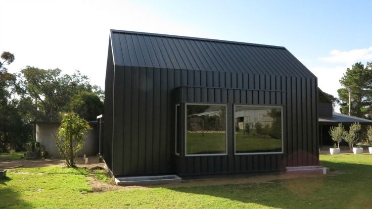 Residential retreat features Colorbond® Nailstrip Roofing and Wall Cladding - True Blue Roofing