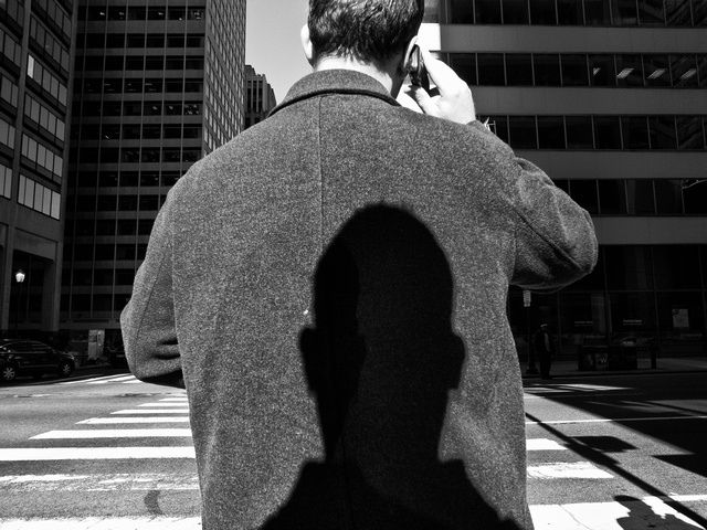 Lee Friedlander - self  Lee Friedlander is an American Photographer. His self portraits would often contain a shadow of his head projected onto people, windows, buildings, etc. He has a famous shot where his head is projected onto a person's back.