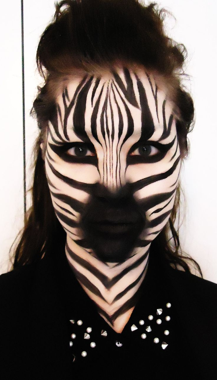 Zebra Products used: · Mac Pure White Chromacake · Makeup sponge · Mac Carbon matte eyeshadow · Mac Blacktrack fluidline · Mac Black Black Acrylic Paint · Br...