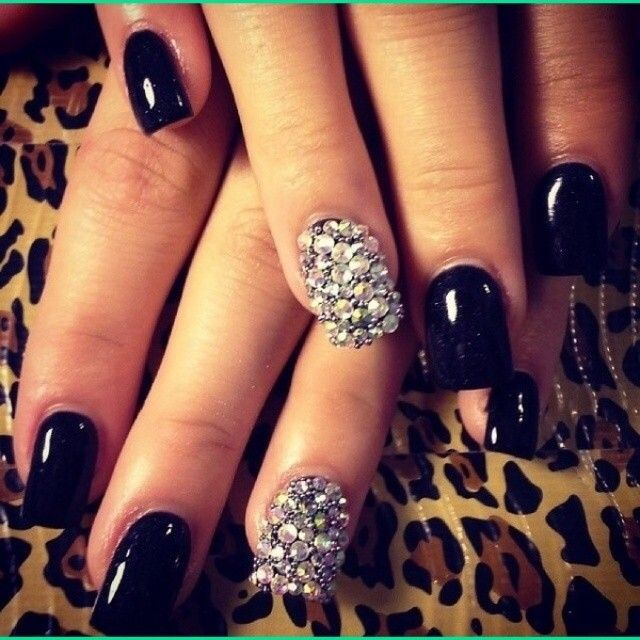 Glamorous black nails with rhinestones covering one nail on each hand...great for prom