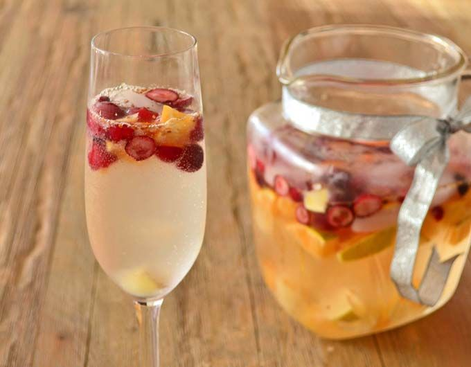 Sangria in the winter? Heck yeah! Especially when you throw in some Champagne, cranberries and oranges.