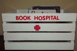 Make a book hospital for your library books that need care.  This one's big enough to hold books and some book care supplies.