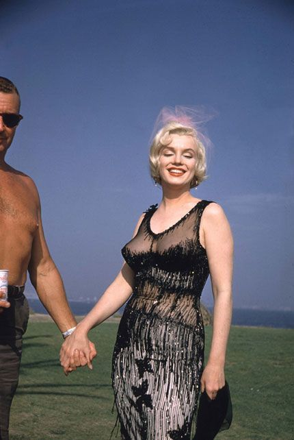 SOME LIKE IT HOT - Marilyn Monroe poses for a photograph in 1959. Very racy dress