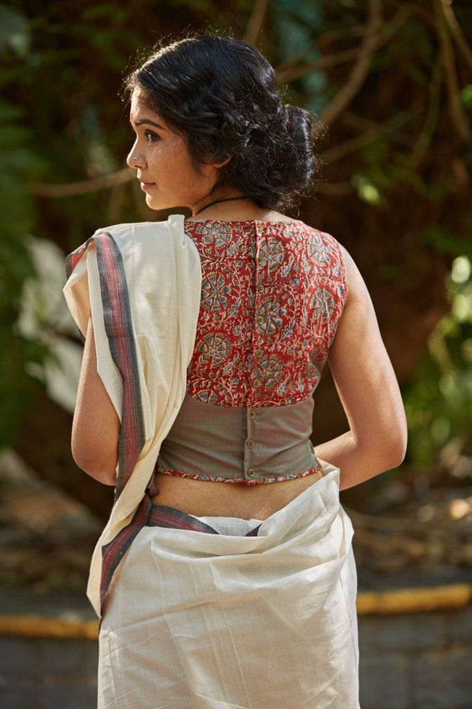 A take on the classic shirt blouse, kalamkari yoke on a green bodice and a button down back. THE KAITHARI PROJECT Handwoven, designed and tailored in Ker...