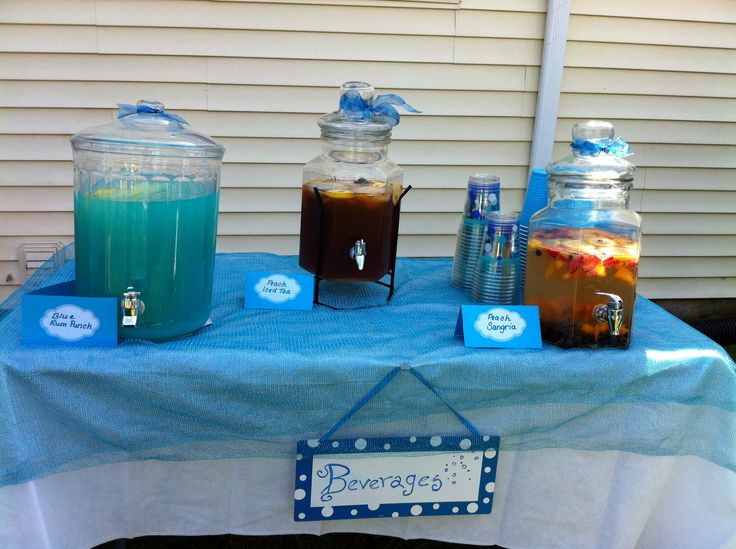 Tiffany blue punch made from blue Hawaiian punch and lemonade. I added some coconut rum for punch:-) The peach sangria recipe was found on Pinterest!