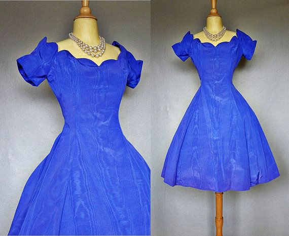 ~ I had a dress like this when I was a little girl in the 1980's!    Vintage party dress / iridescent sapphire by bitterrootvintage, $58.00  Lovely vintage 1980's taffeta party with built-in crinoline. Exquisite sculptural sweetheart neckline, fitted bodice with boning, nipped waist, and very full skirt. Fabric has a pretty iridescent sheen with purple accents in the light. Back zipper. Fabulous.