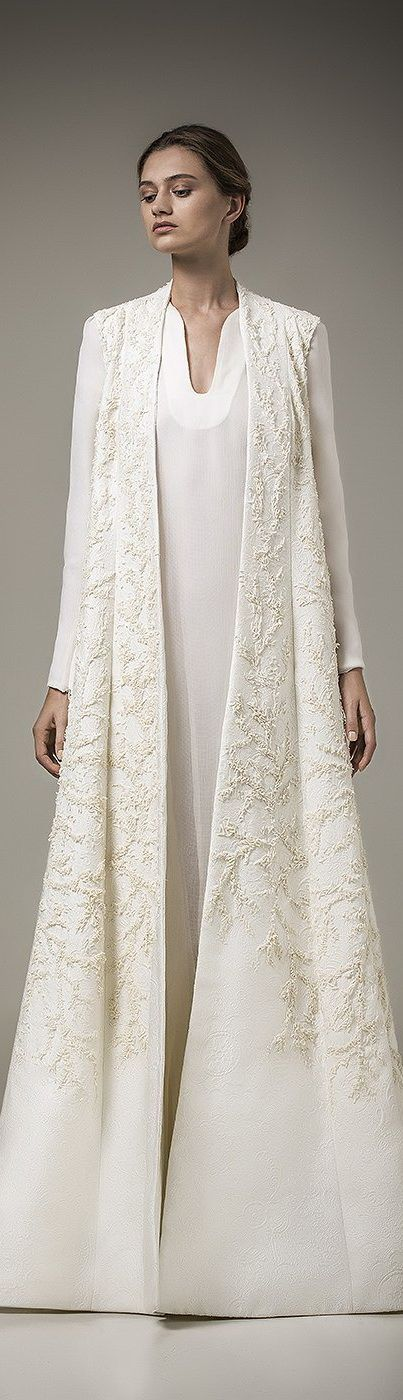 This coat is exquisite. I would have paired it with a different and more compatible dress. qb ashi studio resort 2016