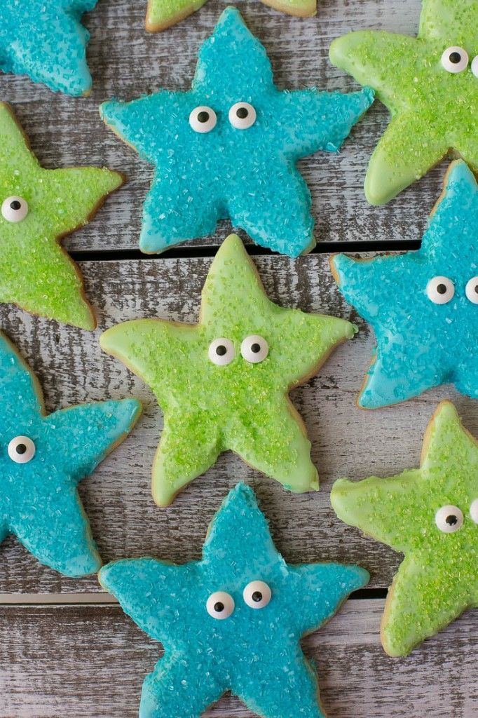 Under the Sea Birthday Party - sugar cookies shaped like starfish dipped in royal icing, sprinkled with sparkling sugar and topped with candy eyes.