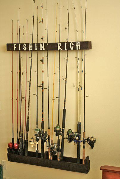 "A simple fishing pole wall rack made from a pallet.  Stained with Minwax ""walnut"" stain and stenciled with white paint."