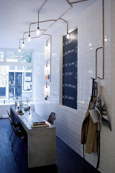 vintage bulbs on copper pipes from A Close Shave: A Cutting-Edge Barber Shop in Amsterdam : Remodelista