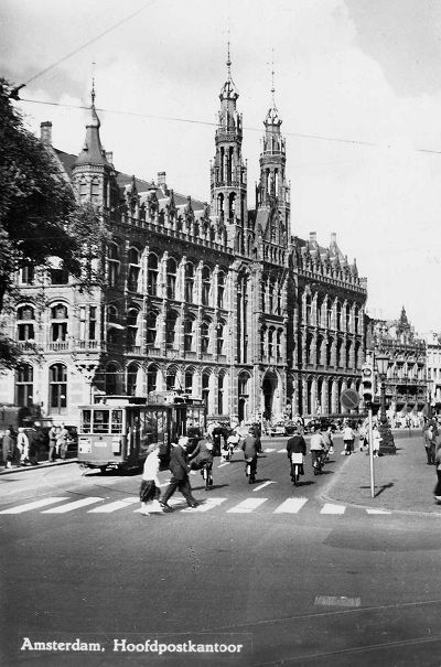 1950's. A view of the main PTT post office of Amsterdam at the Nieuwezijds Voorburgwal. The main post office was built between 1895 -1899 and is the most monumental work by architect C. H. Peters in his very personal mix style of neo-Gothic and neo-renaissance. #amsterdam #1950 #NieuwezijdsVoorburgwal