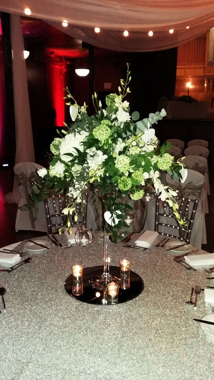 Gorgeous Cream And Green Flowers Foliage Make This Martini Glass Centerpiece The Perfect Balance Between