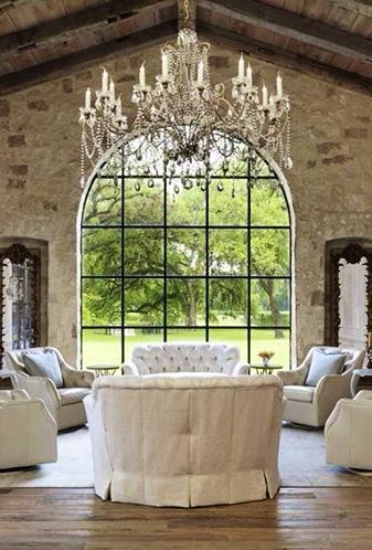 So elegant! Love this large, gracious crystal chandelier in the farmhouse style home. It feels very French country!