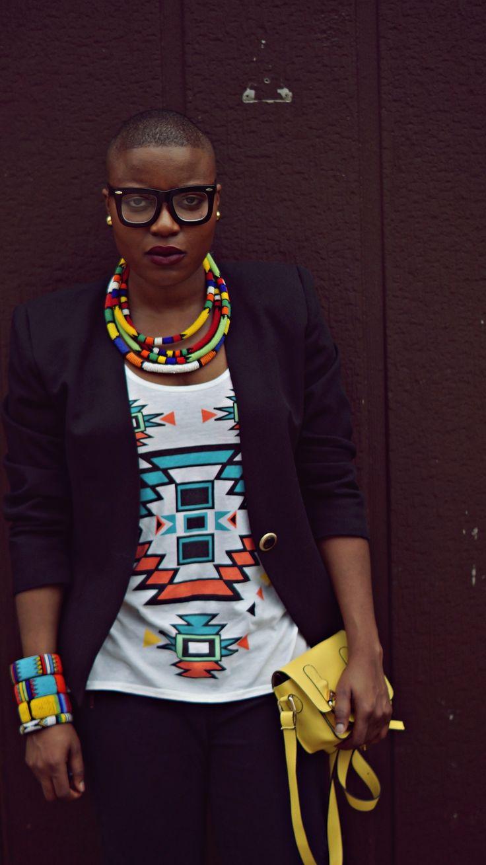 colorful bangles, layered necklaces and a killer handbag to boot