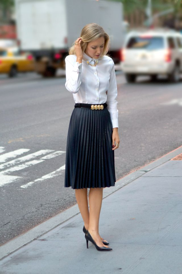 white button down shirt with black accordion skirt