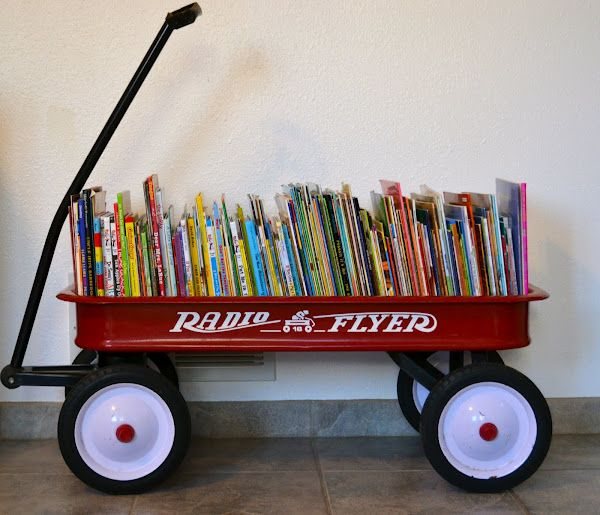 Wagon Bookcase! Brilliant. I need to go find a red radio flyer fast!!! *(Note to Self: this could look really cute in the boys bedroom)