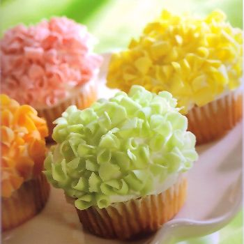 Spring cupcakes made with colored white chocolate curls.