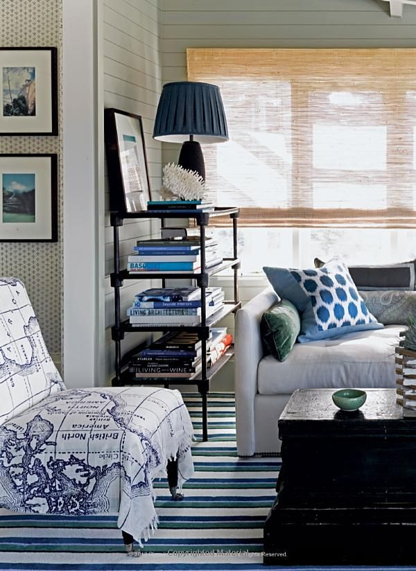Blue And White Living Room With Map Printed Chair Striped Rug Paneled Walls