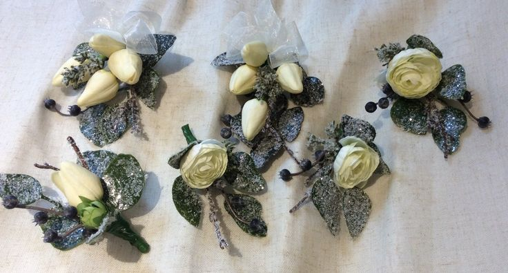 Winter frosted corsages and button holes by Cathey's flowers