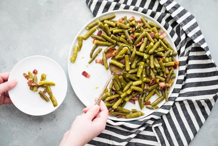 Perfect Whole30 side dish! These Whole30 bacon garlic green beans are simple and delicious, making them a wonderful Whole30 side dish. With only three ingredients, these Whole30 bacon garlic green beans are flavorful and quick. Pair this Whole30 side dish with a simple protein and sauce, and dinner is served! #whole30 #paleo #bacon #whole30recipes #healthy #primal #recipe