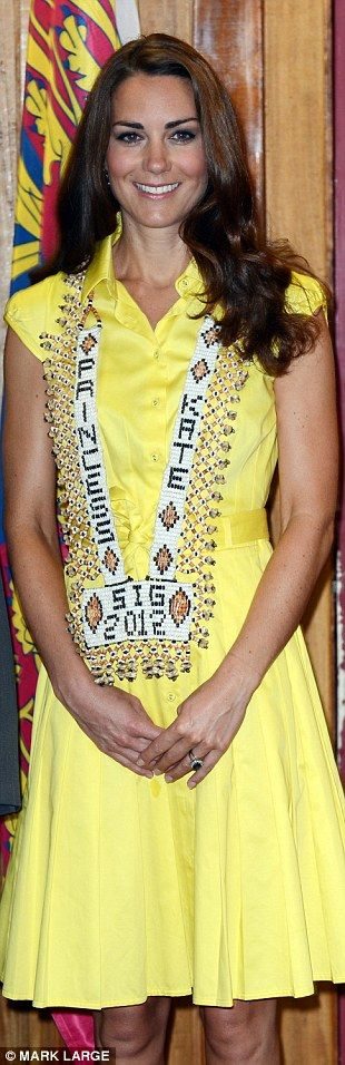 Canary yellow: Kate wore this vibrant, sun-yellow £180 Jaeger dress during her Solomon Islands tour, with a traditional beaded 'Princess Kate' necklace given to her by the country's Prime Minister