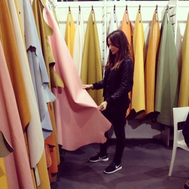 Sandra Sandor founder of #Nanushka selecting fabrics for her SS15 collection  http://the-acey.com/designers/nanushka.html