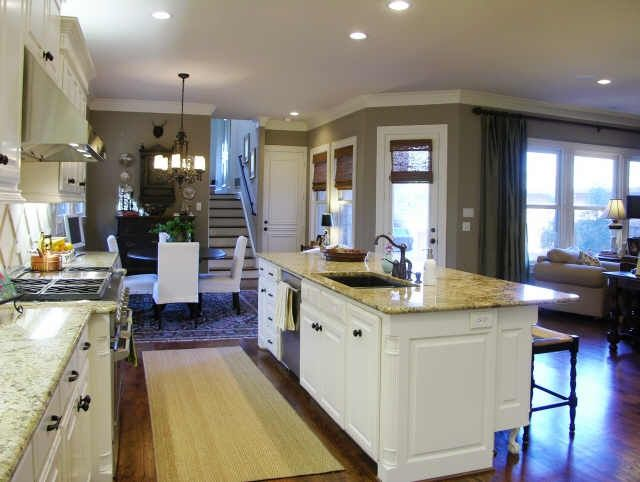 kitchen island with sink and dishwasher and seating — kitchen