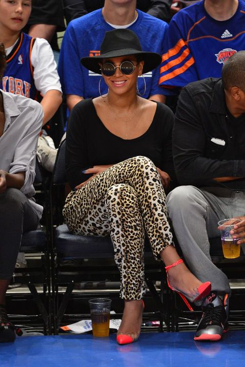 We love Beyoncé's court side style! The singer always looks *oh* so chic.  The shades and wide-brim hat weren't helping if Bey was trying to lay low. She made a bold statement with leopard pants and hot pink ankle-strap pumps.