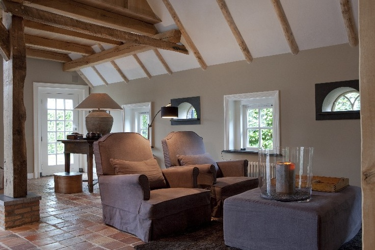 The tiny windows add so much ambiance...& the furnishings beg to be occupied & embraced.  #linenarmchair