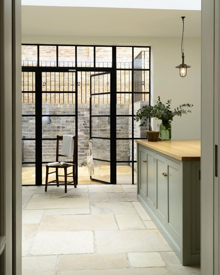 There was a wonderful feeling of calm as you entered this stylish deVOL Kitchen in Islington, North London. The bespoke cupboards painted in soft green were substantial and provided plenty of storage but also felt unimposing and quiet, fitting with the flow of this beautiful family home. #deVOLKitchens