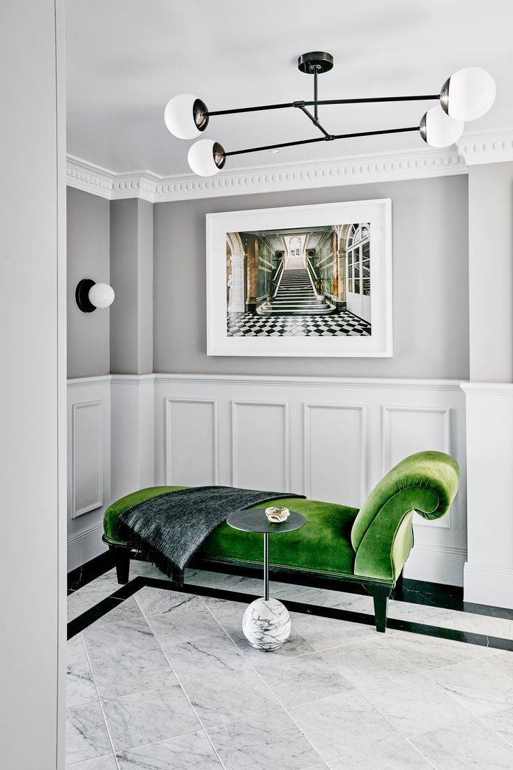 Classic features such as panelling, marble floors and intricate cornices feel revitalised in this apartment in Sydney's Elizabeth Bay, when paired with vibrant modern artworks and a statement green velvet chaise lounge.  Photography: Will Horner