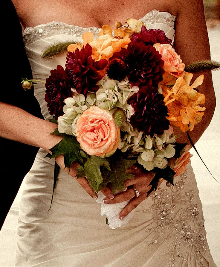 Beautiful Fall themed wedding bridal bouquet. Maroon flowers bouquet and peach roses bride bouquet. Perfect for a fall wedding. Loving the combination of the greens mixed with colors.