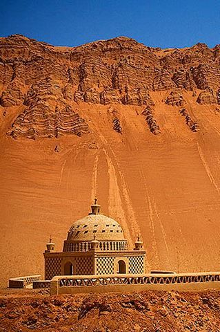 Xinjiang Turpan Flaming Mountain with a Tiny Muslim Shrine. Silk road