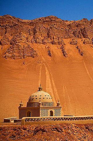 Xinjiang Turpan Flaming Mountain with a Tiny Muslim Shrine. Silk road (China)