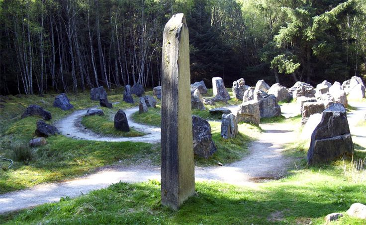 """Touchstone Labyrinth in Blackmuir Wood, Strathpeffer. Illustrates the different rock types and geological ages found in Scotland. And the labyrinth is based on Celtic and Pictish designs. Information boards identify the rock type for each boulder and explain how alignment of the """"arms"""" is related to events such as the solstice. Really just a spiral."""