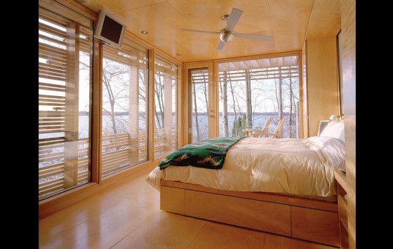 Dormitorio de casa de madera