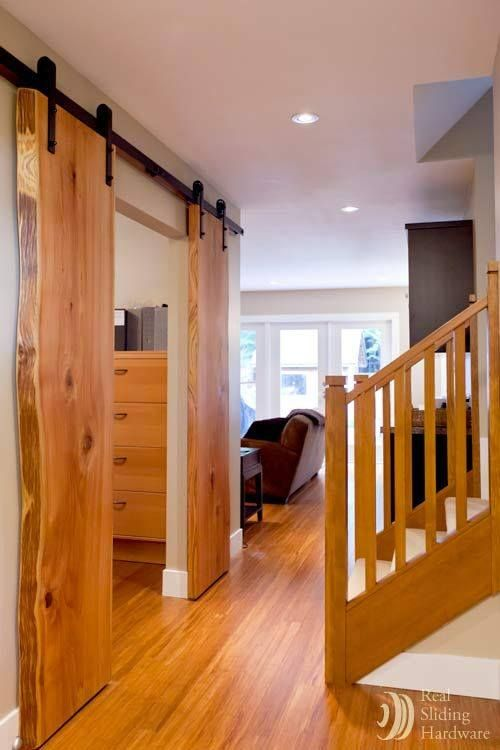 hang live edge slabs from a rail system for an open natural look