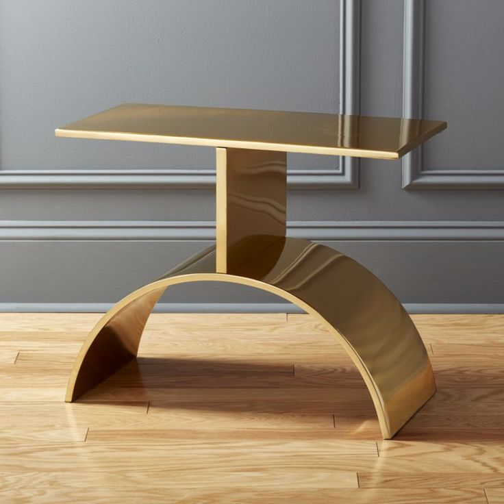 Shop Curve Gold Side Table.   Vintage-inspired design by Brett Beldock veers into modern territory.  Inspired by a '60s table owned by Beldock's aunt, top and curved base are cut from a steel sheet, bent and welded together and finished in warm gold.