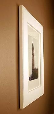 Picture frame is really a concealed medicine cabinet!