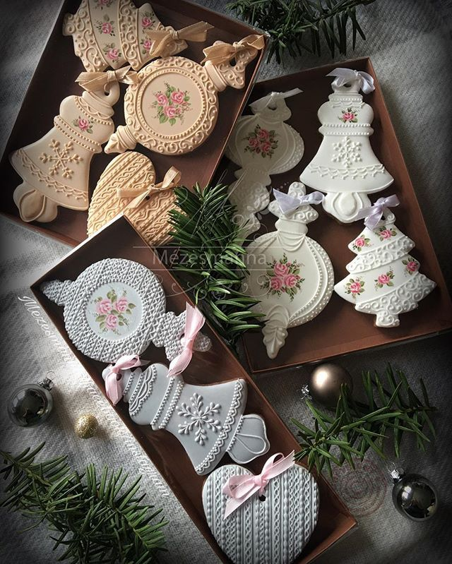 Gingerbread ornaments. #ornaments #gingerbread #mezesmanna #cookies #gift #christmas #christmascookies #ornament #royalicing #icingcookies #rose #handmade #handpainted #grey #white #iloveit #ilovechristmas #instagram #instagood #instaart #instadaily
