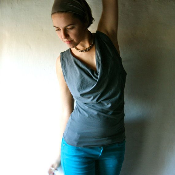 This sleeveless cotton blouse has a dramatic drape in front and is fitted around the waist area, to contrast the looseness around the bust. It is the closed-back version of my bestselling halter top. It looks the same from the front, but covers your shoulders in back.  It is made with a quality cotton knit, pictured in dark grey, it can be custom made in other colors, see the color chart and choose from the menu!  • MATERIALS & CARE: 95% cotton, 5% elastane Machine washable, high quality…
