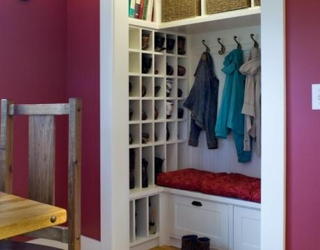 Possible use for tiny living room closet. Closet converted into mini coat room complete with shoe cubby and storage!