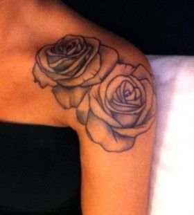 Black and white rose tattoo on shoulder
