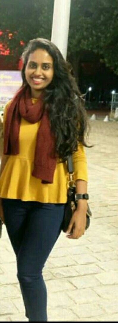 Mustard yellow peplum top paired with an oxblood scarf and high waisted jeans.