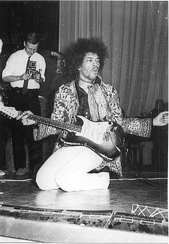 Jimi Hendrix: A b&w shot of the show with the well-worn sunburst. This isn't a commonly seen Strat (even has a replaced (black) tone knob) and may have been one he borrowed for a while - as he reportedly did with his first Strat.