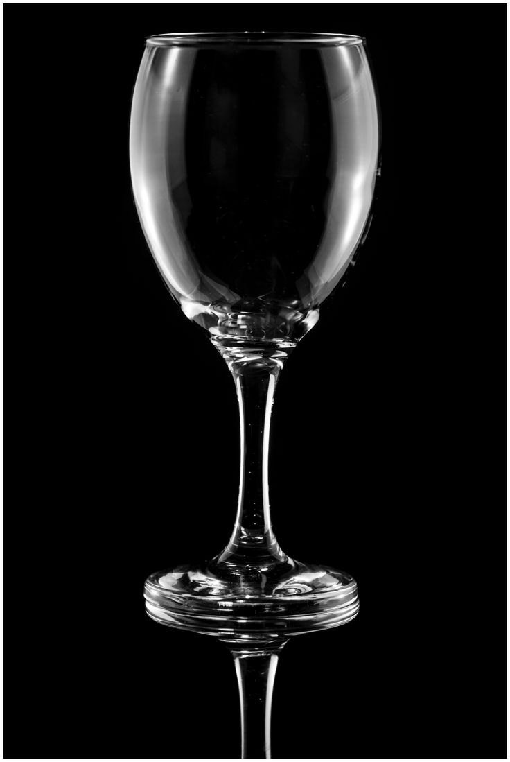 Wine glass reflections on black..