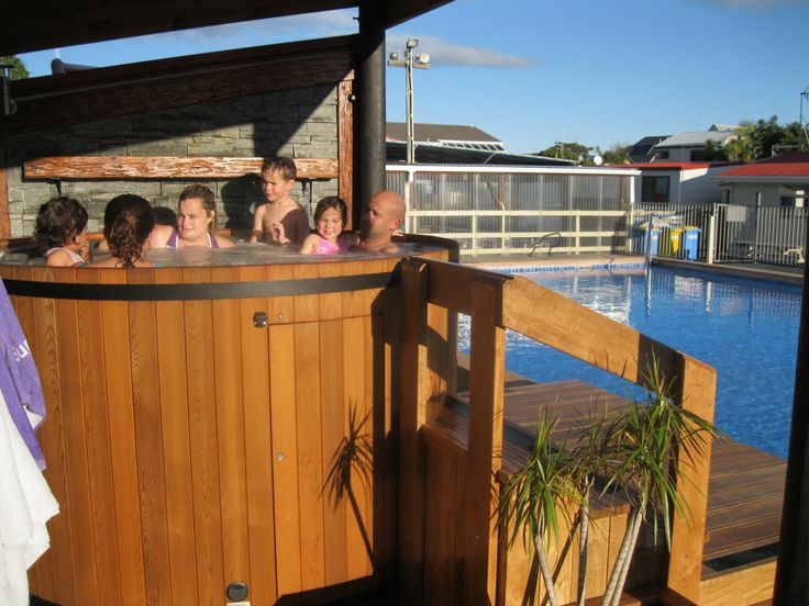 Relaxing in the Hot Tub Cosy Corner Holiday Park, Mt Maunganui, New Zealand